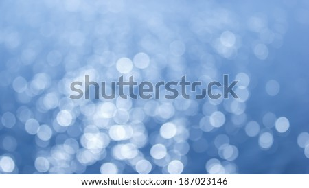 blue bokeh background of Light shining on the river, Abstract river shot in manual mode out of focus. - stock photo