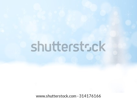 Blue bokeh background of silver christmas tree with copyspace for text - stock photo
