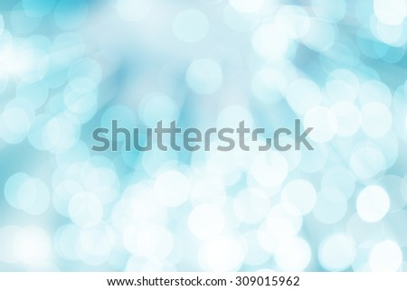Blue bokeh glitter defocused lights abstract background