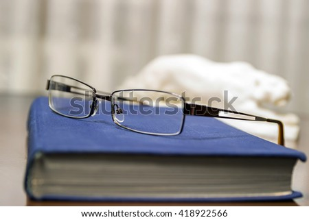 Blue Book and glasses. Reading, learning books.  - stock photo