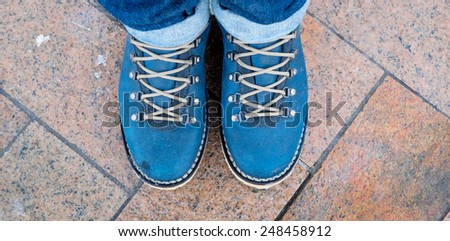 blue boots with shoelace - stock photo