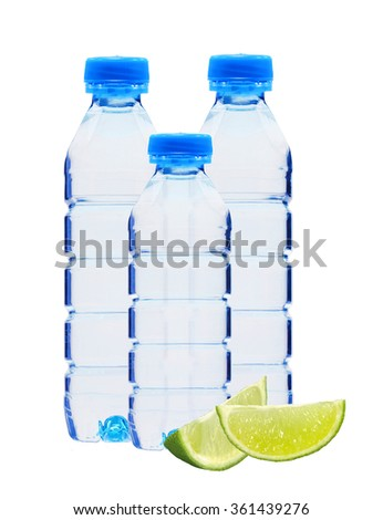 Blue bottles with water and lime slices isolated on white background - stock photo
