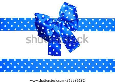 blue bow and ribbon with white polka dots made from silk isolated - stock photo
