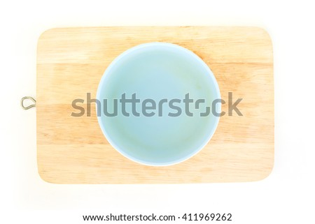 blue bowl top view on wood background - stock photo