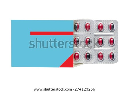 Blue box with red pills in a blister pack on an isolated background - stock photo