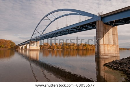 Blue bridge over Mississippi River at Marquette, Iowa - stock photo