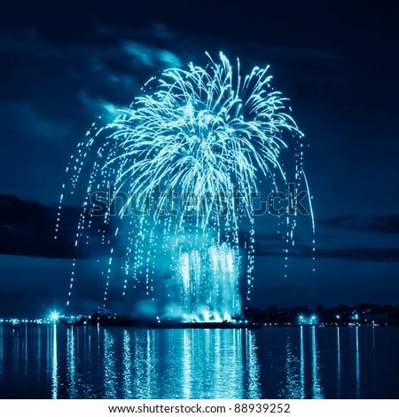 Blue bright firework in a night sky - stock photo