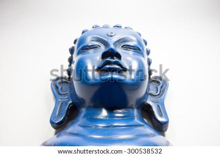 Blue Buddha. Buddha on a white background. - stock photo