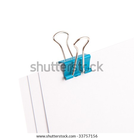 Blue bulldog clip holding three sheets of paper.