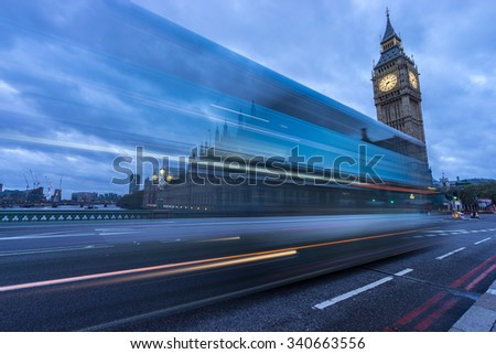 Blue Bus in motion in front of Big Ben - London, England  - stock photo