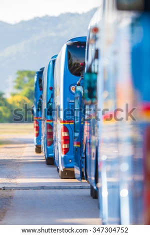 Blue bus parked cars line snap. - stock photo