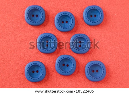Blue buttons on red background - stock photo