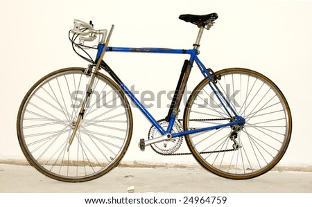 blue bycicle on white vintage background. photo image - stock photo