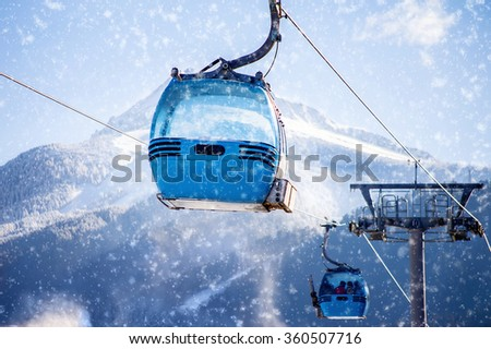blue cable car lift at ski resort - stock photo