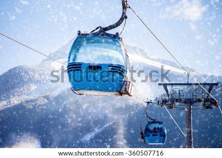 blue cable car lift at ski resort - stock photo