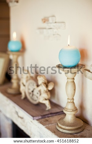 blue candles on wooden candlestick - stock photo