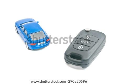 blue car and black car keys on white - stock photo