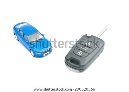 blue car and car keys on white - stock photo