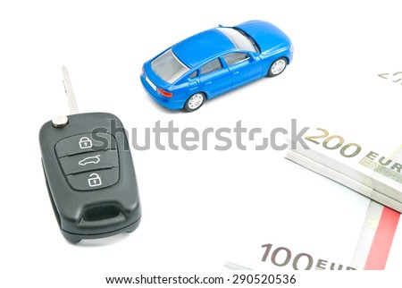 blue car, euro notes and black car keys on white - stock photo