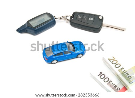 blue car, keys and banknotes on white closeup - stock photo