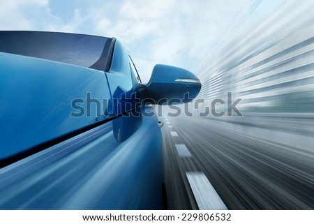 Blue car on city road - stock photo
