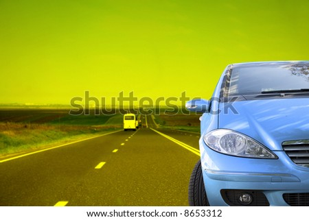 Blue car on the road - stock photo