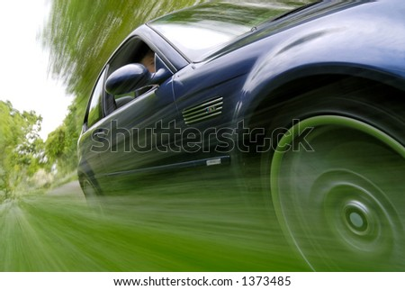 Blue Car Speeding - stock photo