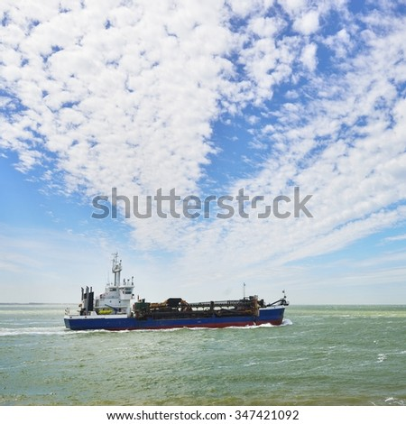 Blue cargo ship (tanker) is sailing near Vlissingen, the Netherlands