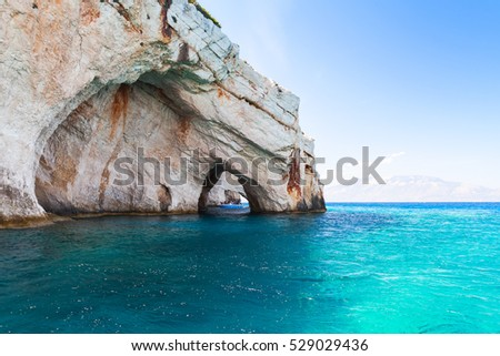 Blue caves, coastal rocks of Greek island Zakynthos with natural stone arches