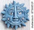 Blue ceramic sun sign - stock photo