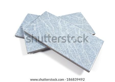 Blue ceramic tiles on white  - stock photo
