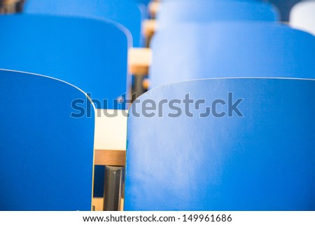 blue chair and table in classroom - stock photo