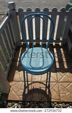Blue chair in garden                  - stock photo