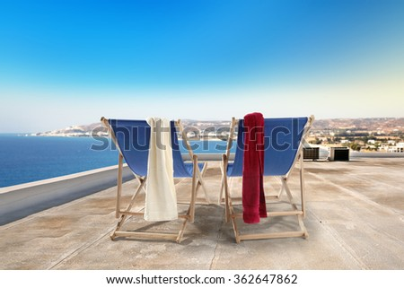 blue chairs and towels