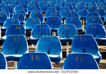 blue chairs in the stands - stock photo
