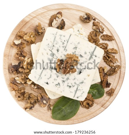 blue cheese decorated with arugula and walnut on wooden board is - stock photo