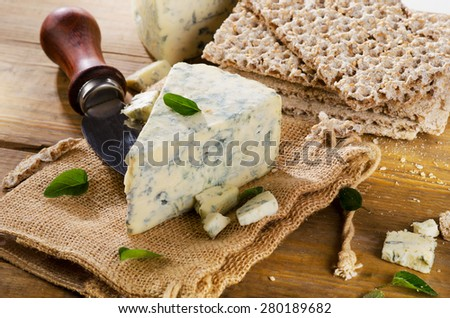 Blue cheese on a wooden background. Selective focus - stock photo