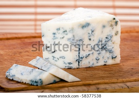 Blue cheese on cutting wood