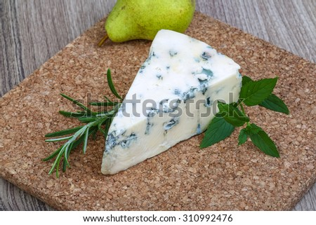 Blue cheese with rosemary and green pear - stock photo