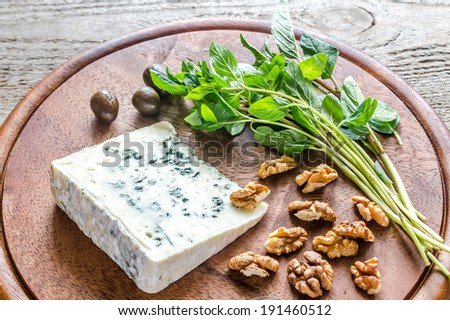 Blue cheese with walnuts and fresh mint - stock photo
