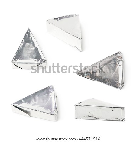 Blue cheese wrapped in silver foil isolated over the white background, set of five different foreshortenings - stock photo