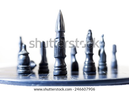 blue chess pieces on white background - stock photo