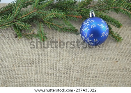 Blue Chirstmas decoration and a pine branch - stock photo