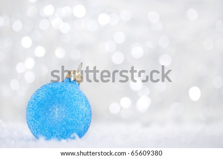 Blue christmas ball on abstract light background. - stock photo