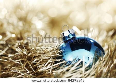 blue christmas ball on golden background - stock photo