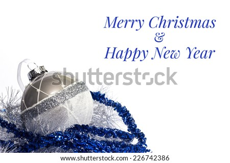 Blue Christmas ball with silver and blue garland. Isolated on a white background. - stock photo