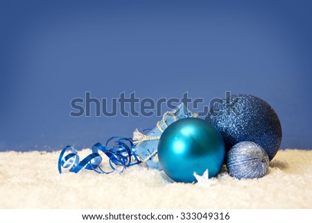Blue christmas balls isolated .Christmas decoration and snow background.