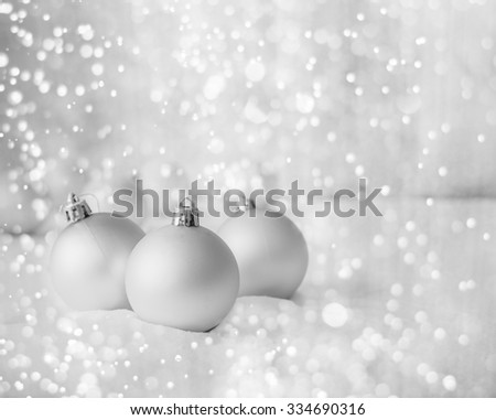 Blue Christmas balls on the white snow - stock photo