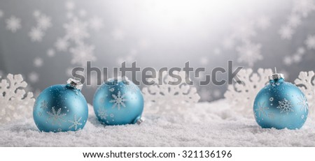 Blue Christmas balls with decoration on shiny background - stock photo