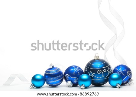Blue Christmas balls with ribbons isolated on white. - stock photo